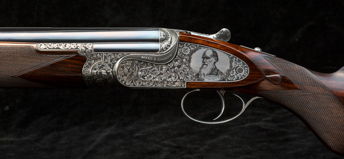 Darwin-engraved-onto-sideplated-over-and-under-Boxall-and-Edmiston-shotgun-British-made-bespoke